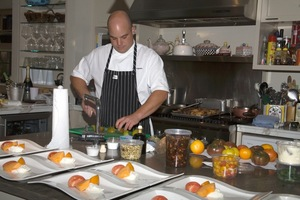 Nash Tra Vigne preparing meal for an event at Jaff
